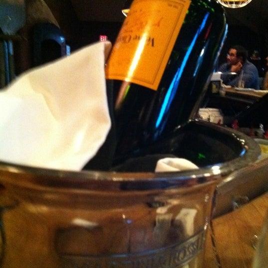 Photo taken at JoJo Bistro & Wine Bar by Kara M. on 11/5/2011