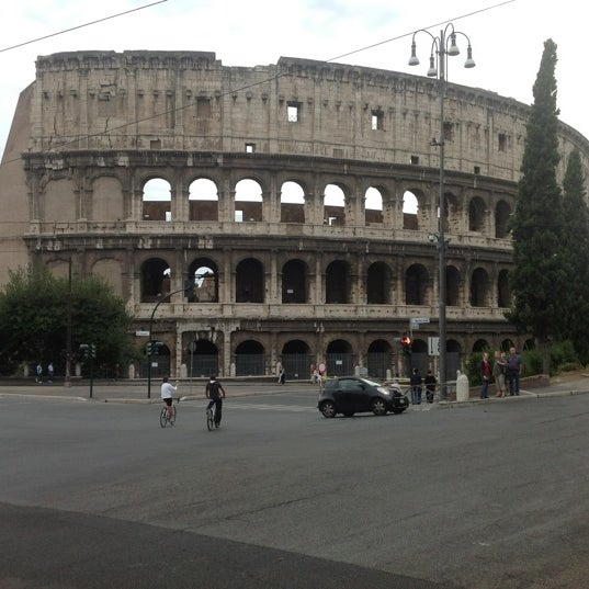 Photo taken at Piazza del Colosseo by Дмитрий on 9/2/2012