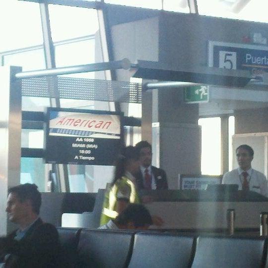 Photo taken at Gate 5 Aeropuerto Internacional Juan Santamaria by Javier L. on 3/7/2012