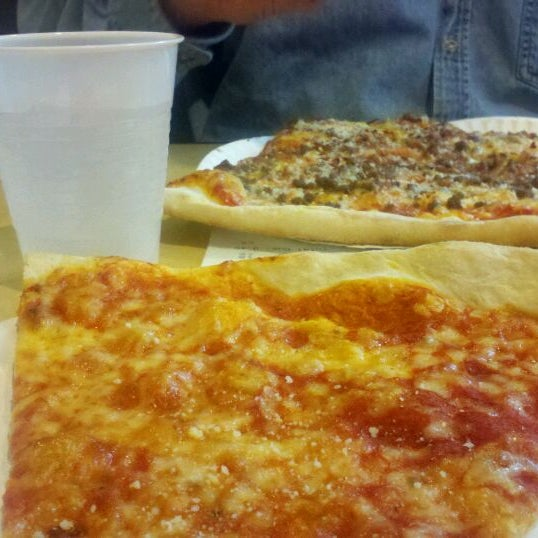Photo taken at Burke Street Pizza by Nancy T. on 1/14/2012