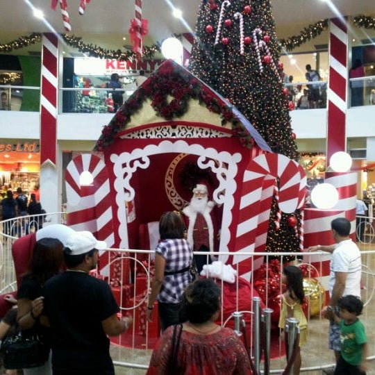 Photo taken at Trincity Mall by Andrew M. on 12/17/2011