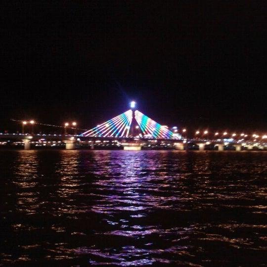Photo taken at Cầu Sông Hàn (Han River Bridge) by Adrian A. on 1/25/2012