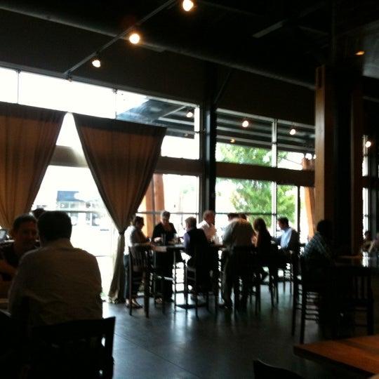 Photo taken at 5 Seasons Brewing by Erik L. on 7/15/2011