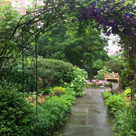Photo taken at The Garden at St. Luke in the Fields by Gene S. on 5/24/2012