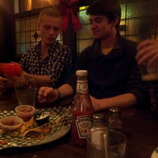 Photo taken at The Old Triangle Irish Alehouse by Sarah L. on 12/23/2011