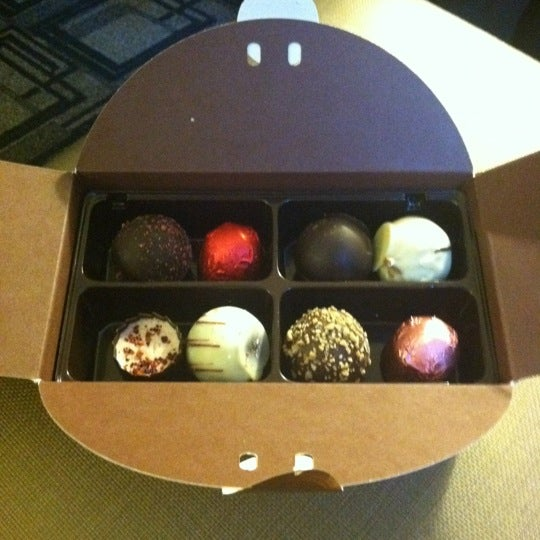 Photo taken at Godiva Chocolatier by Cori M. on 12/23/2011