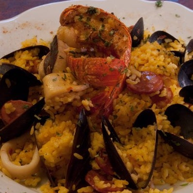 Taste: Relleno de gambas (shrimp in plantains); Salmon tapas; Beso chicken(hin fillets under a light porcini mushroom sauce borrowed from Italy beside a stewed tomato-onion mix); Paella; Sopapillas