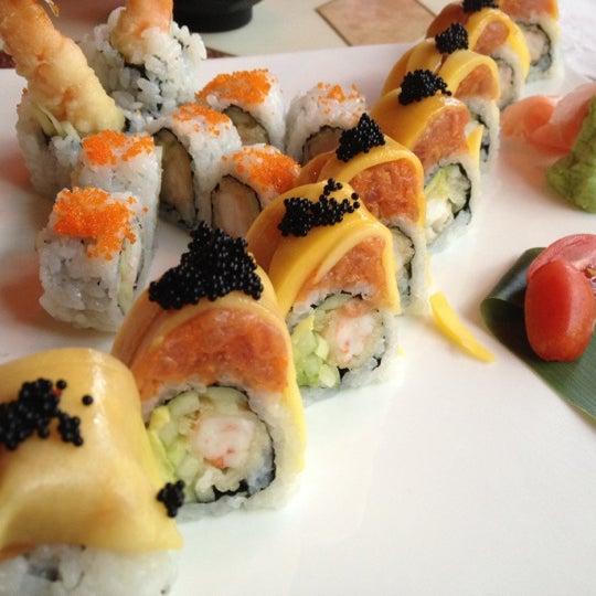 Photo taken at Sushi Cafe by Jojo H. on 2/24/2012