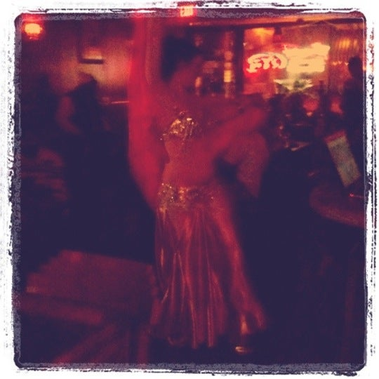 Photo taken at Nara Cafe Hookah Bar by Angie R. on 3/12/2011