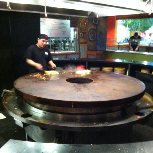 Photo taken at HuHot Mongolian Grill by Justin B. on 3/19/2012