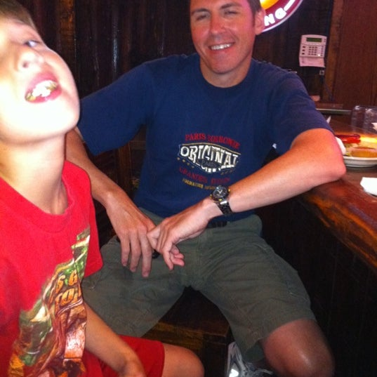 Photo taken at Cave Creek Smokehouse & Pour House Patio by Patty S. on 7/29/2011