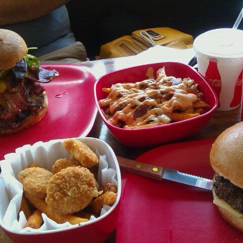 Photo taken at G Burger by Andrea V. on 4/9/2012