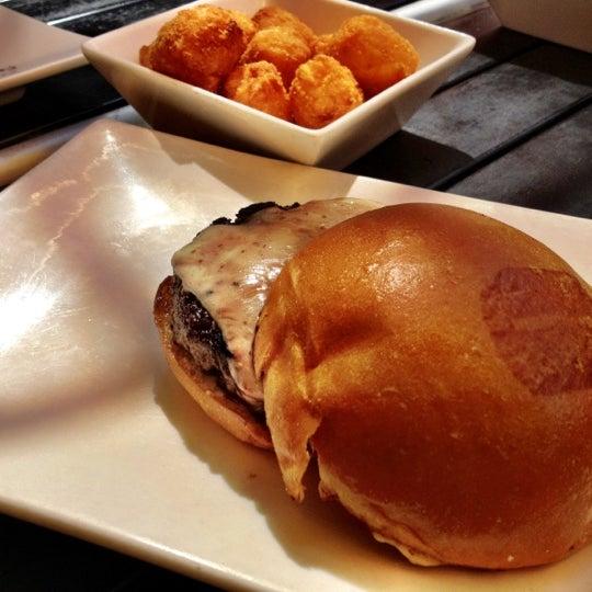 Photo taken at Umami Burger by Junior M. on 4/4/2012