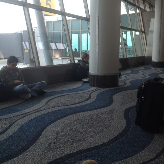 Photo taken at Gate 5 Aeropuerto Internacional Juan Santamaria by Chris on 4/20/2012