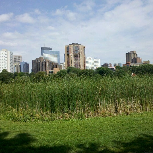 Photo taken at Loring Park by Morgan J. on 8/15/2012