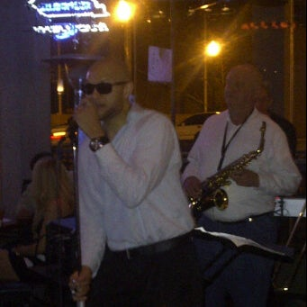 Photo taken at Bigg Blue Martini by Allegra E. on 3/11/2012