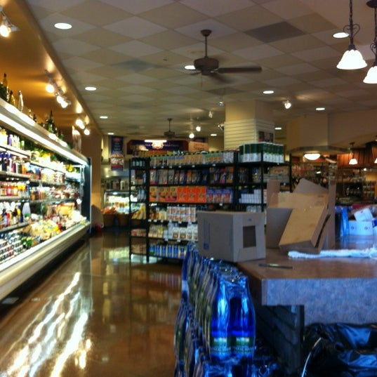 Photo taken at Tony's Market by Mark W. on 6/20/2012