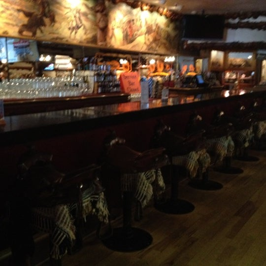 Photo taken at Million Dollar Cowboy Bar by Carly Hana P. on 8/13/2012