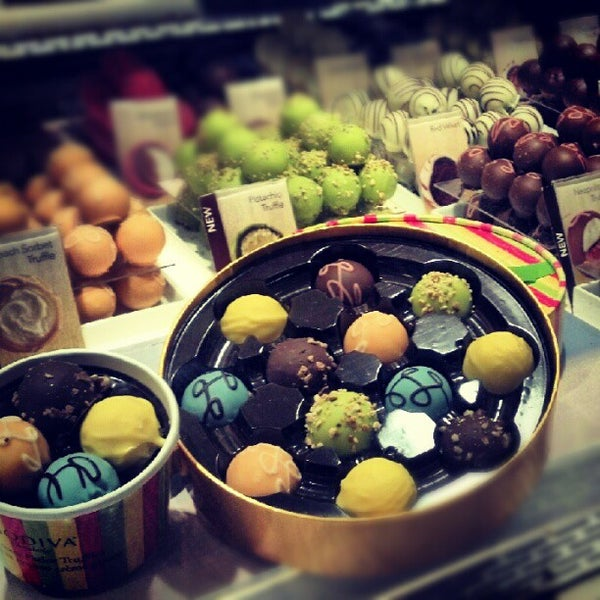 Photo taken at Godiva Chocolatier by irina k. on 6/9/2012