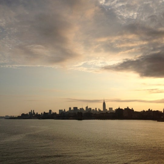 Photo taken at New York Harbor by Alissa R. on 7/8/2012