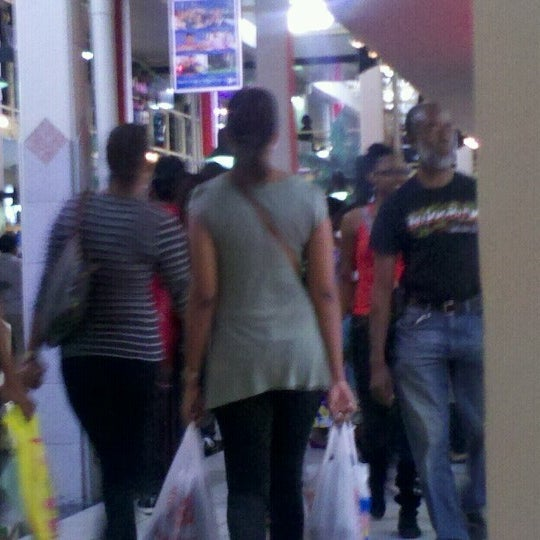 Photo taken at Trincity Mall by Melissa M. on 9/1/2012