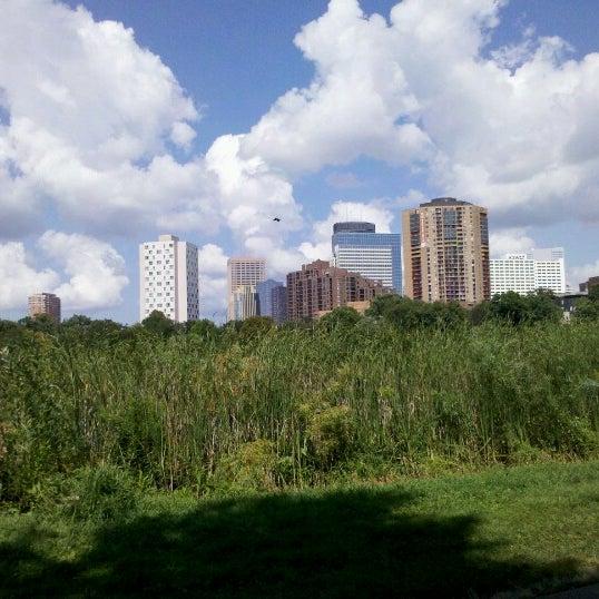 Photo taken at Loring Park by Morgan J. on 8/13/2012