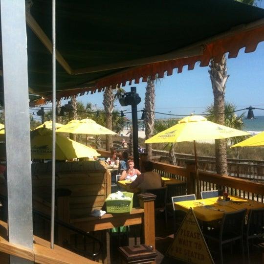 Photo taken at Landshark Bar & Grill by Jason K. on 3/23/2012