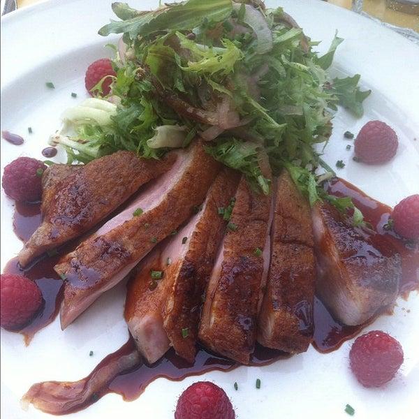Photo taken at Left Bank Brasserie by Derek S. on 5/25/2012