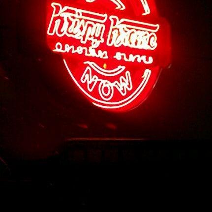 Photo taken at Krispy Kreme Doughnuts by Cyrena C. on 4/26/2012