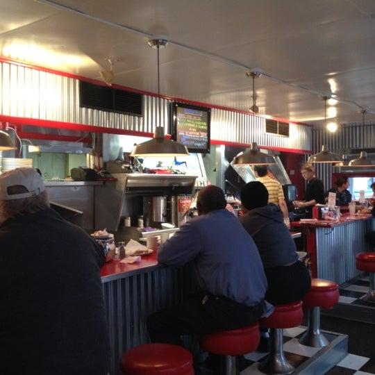 Photo taken at Donut Dinette by Chris K. on 3/5/2012