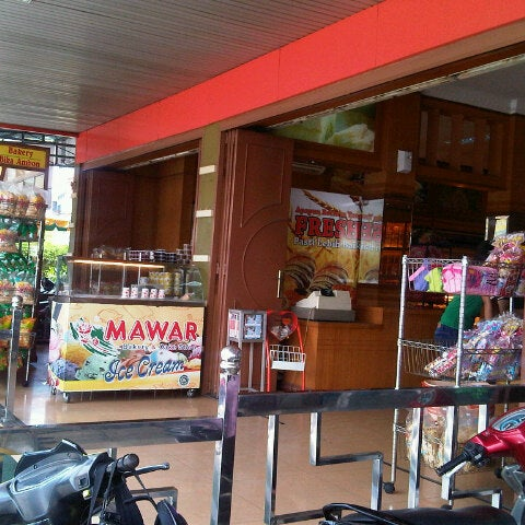 Photo taken at Mawar Bakery and Cake Shop by Bl A. on 9/1/2012