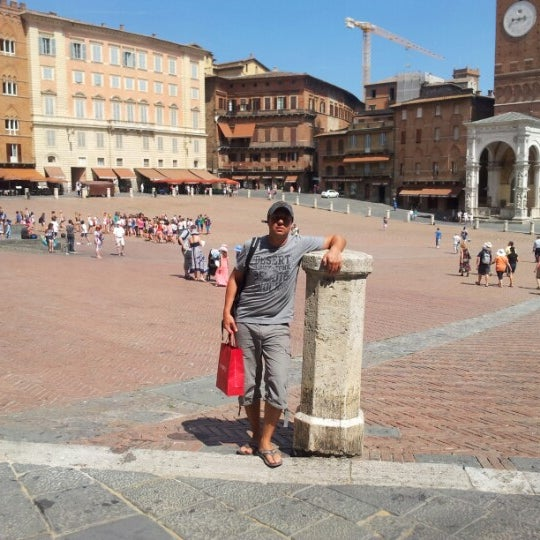 Photo taken at Piazza del Campo by Remco V. on 8/2/2012
