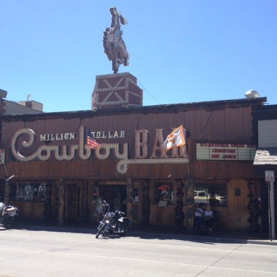 Photo taken at Million Dollar Cowboy Bar by Peter A. on 6/30/2012