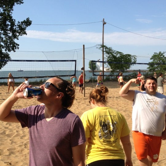 Photo taken at Whiskey Island Volleyball Courts by Tim B. on 7/1/2012