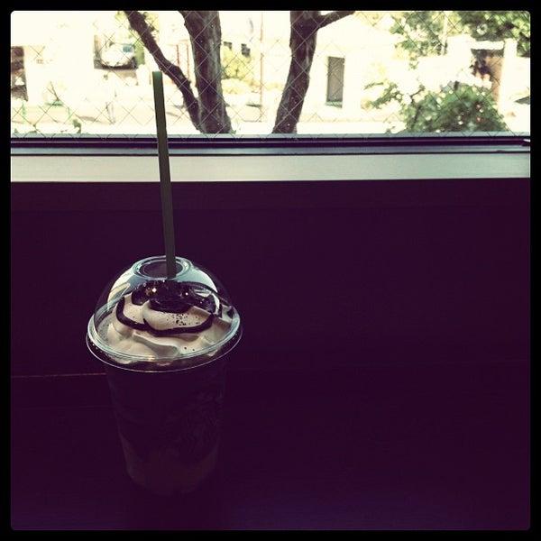 Photo taken at Starbucks Coffee 神楽坂下店 by Takashi K. on 5/5/2012