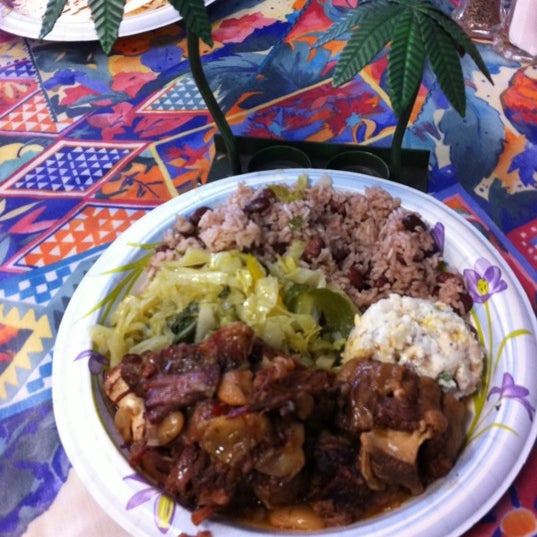 Photo taken at Mama Jamaica's Kitchen by Conrad & Jenn R. on 2/17/2012