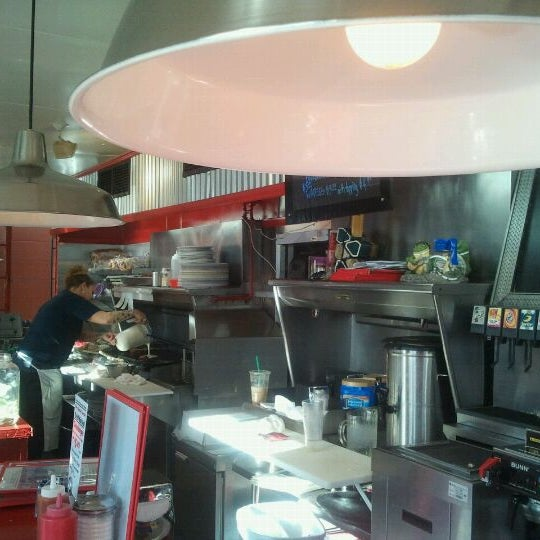 Photo taken at Donut Dinette by Colleen B. on 3/7/2012