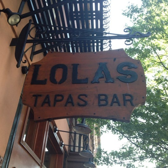 Photo taken at Lola Tapas & Wine Bar by Adriana C. on 5/19/2012