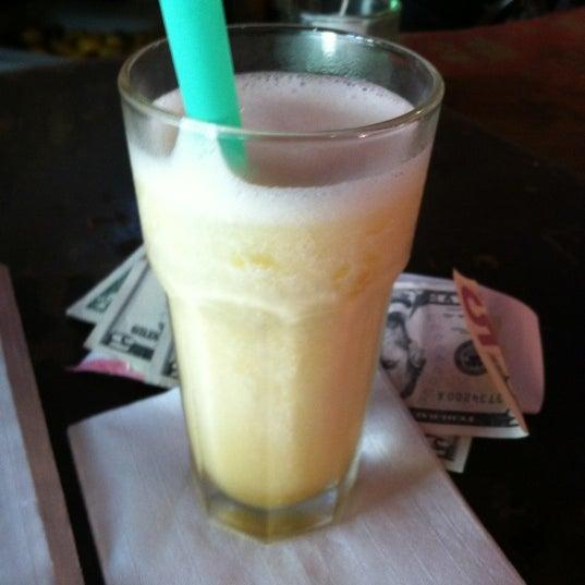 Photo taken at Burrito Bar & Kitchen by Michelle Y. on 6/29/2012