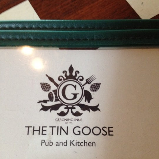 Photo taken at The Tin Goose (Pub & Kitchen) by Jason C. on 7/4/2012