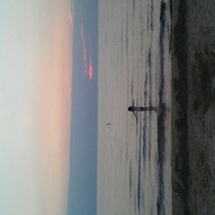 Photo taken at Silver Beach by Jorge P. on 8/16/2012