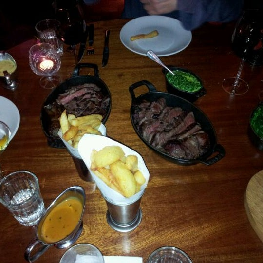 Photo taken at Hawksmoor Seven Dials by Ady L. on 3/17/2012