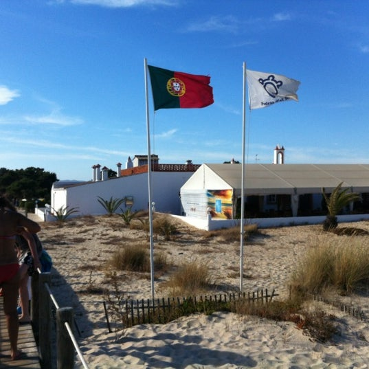 Photo taken at Praia do Barril by Dan San on 8/13/2012