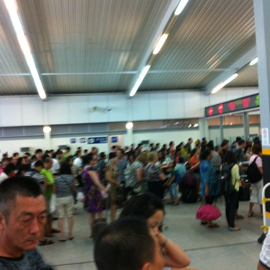 Photo taken at Taipa Ferry Terminal | Terminal Marítimo de Passageiros da Taipa | 氹仔客運碼頭 by Rynn R. on 7/16/2012