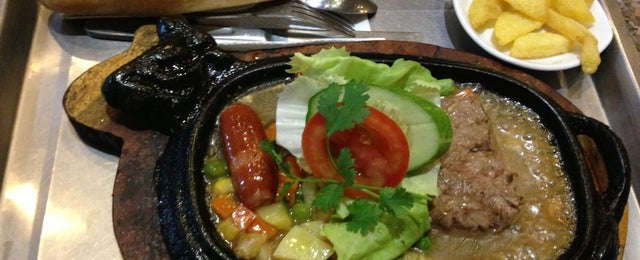 Photo taken at Asteria Steak House by Doan C. on 2/2/2013