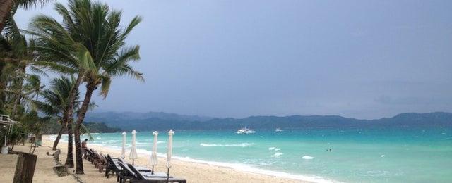Photo taken at White Beach by Roussel on 10/1/2012